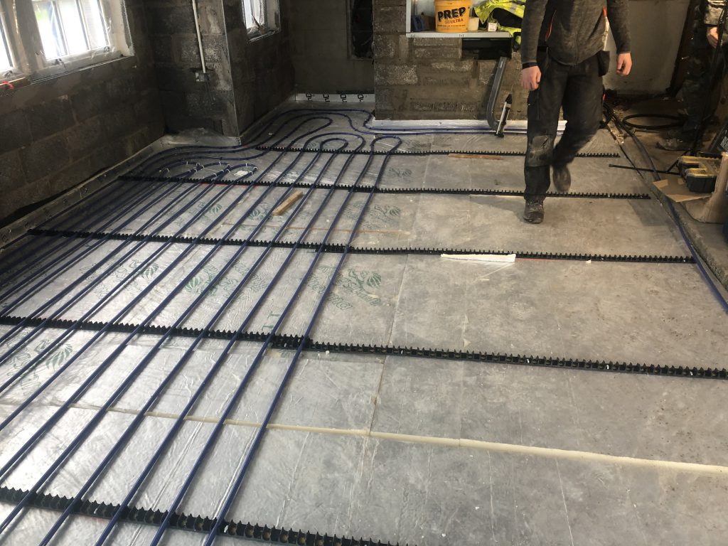 Image displaying underfloor heating being installed